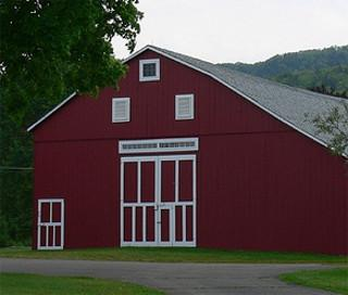 front of red barn